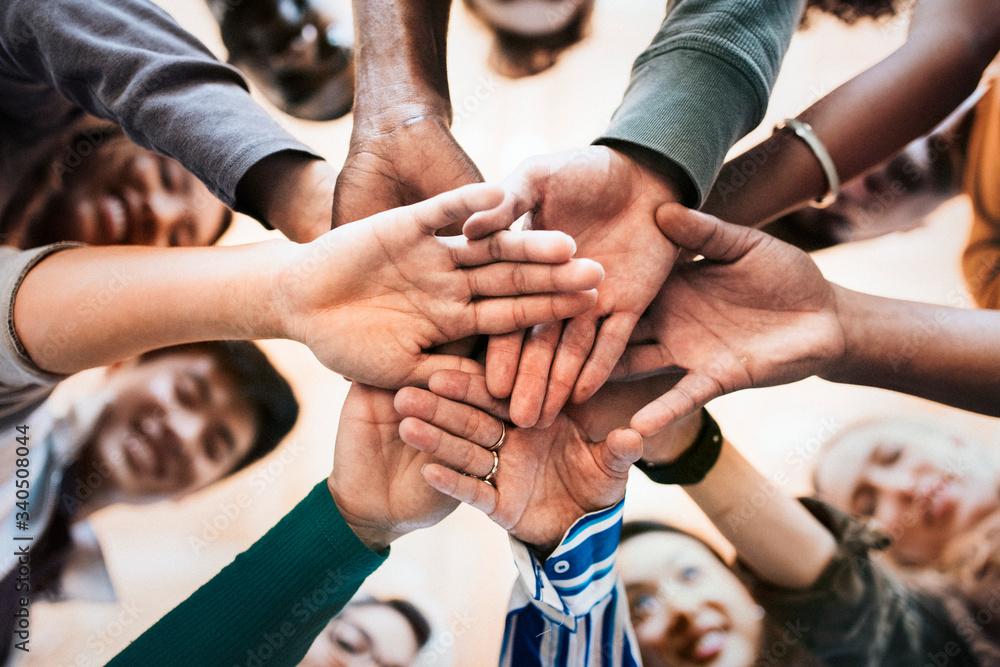 Fototapeta Group of people hands together
