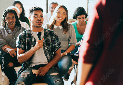 Fotografie, Obraz Man holding a microphone