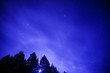 Leinwanddruck Bild - Low Angle View Of Silhouette Trees Against Blue Sky At Night