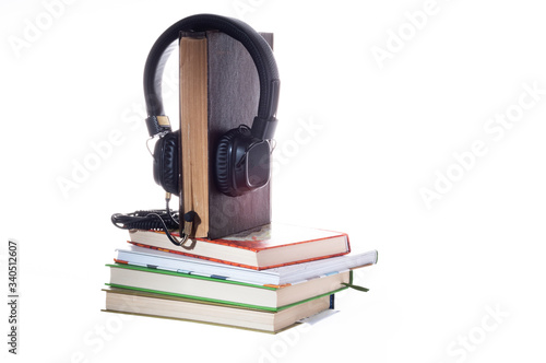 Listening to books through headphones Canvas Print