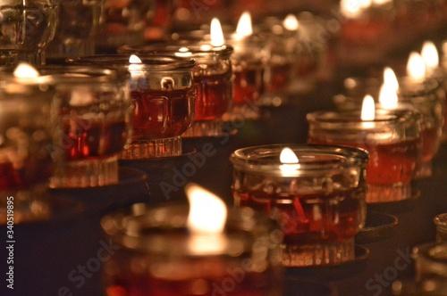 Fototapeta Close-up Of Tea Light Candles In Temple obraz