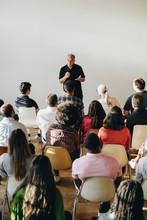 Senior Man Talking In A Seminar