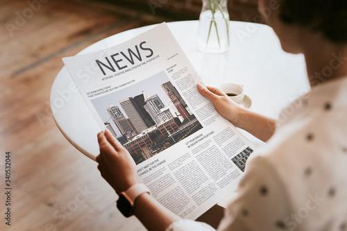 Woman reading a newspaper Canvas Print
