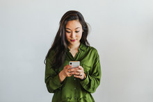 Happy Woman Texting On A Phone