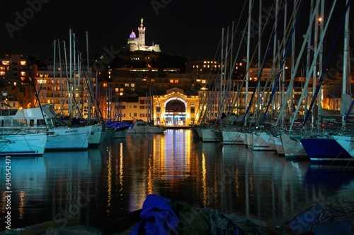 Fototapeta Boats Moored At Old Port Of Montreal In Illuminated City obraz