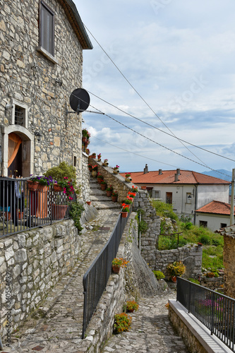 A narrow street between the old houses of Gesualdo, a village in the province of Wallpaper Mural