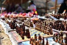 Close-up Of Figurines For Sale At Market