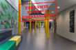 Defocused view of interior of college, empty and closed due to covid 19 with Polish notice Closed due to Coronavirus