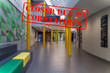 Defocused view of interior entrance of college, empty and closed due to coronavirus