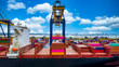 canvas print picture - Quay crane, Crane of container terminal in industrial sea port, Sea cargo port with container ship and crane with blue sky background, Business logistic import export transportation by cargo vessel.