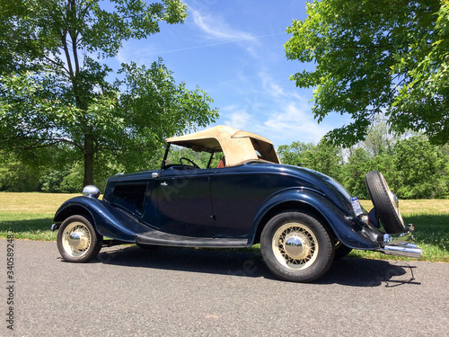 1934 Ford Roadster blue in park on green grass outdoor sky Canvas Print