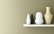 Vases On Shelf By Wall
