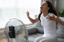Overheated Woman Enjoying Fres...