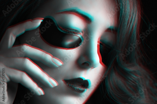 Photo Anaglyph effect of woman with fashion dark makeup and black under eyes hydrogel patches