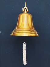 Low Angle View Of Bell Hanging Against Wall