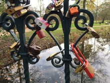 Close-up Of Love Locks Hanging On Railing In Park