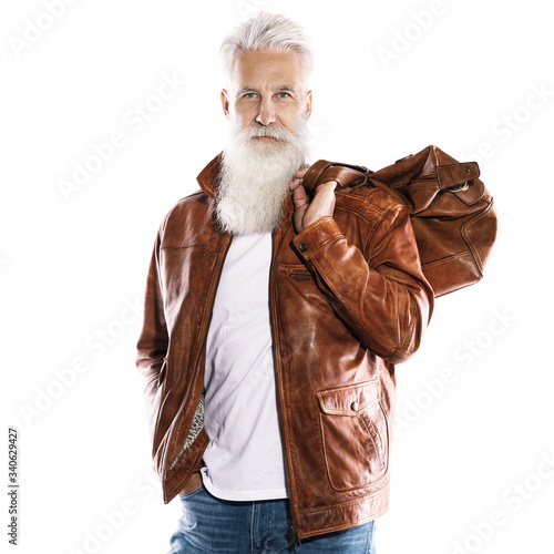Handsome bearded senior man with leather bag and jacket on white background