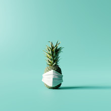 Pineapple With Mask On Pastel Blue Background. Creative Idea. Minimal Concept. 3d Rendering