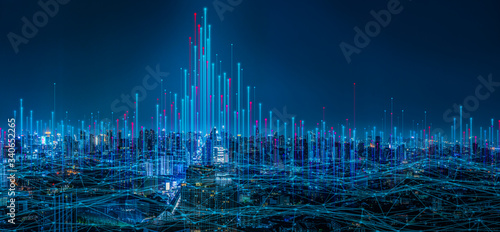 Obraz Modern city with wireless network connection and city scape concept.Wireless network and Connection technology concept with city background at night. - fototapety do salonu