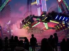 People Looking At Illuminated Amusement Park Ride During Night