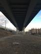 Slowly walking under the bridge