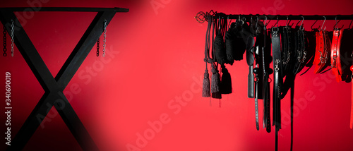 erotic games and human sexuality concept. kinky sex toys for  BDSM fantasy play (ball gag, cuffs, rope, flogger, collar and leash)