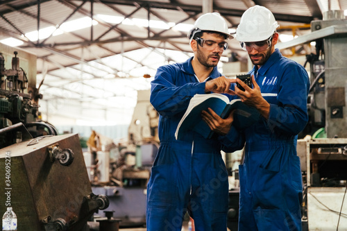 Fototapeta Group of industrial factory maintenance engineers inspect relay protection system using walkie talkie with copy space for your text. Industry, Maintenance, Engineering and construction concept. obraz