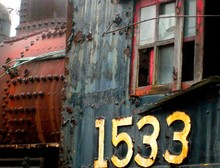 Closeup Shot Of An Old And Rusty Steam Engine Of An Old Locomotive