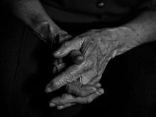 Elderly Woman Folded Her Hands...