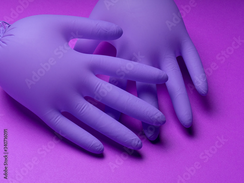 Pair of latex medical gloves on purple background Tapéta, Fotótapéta