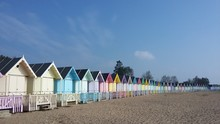 Row Of Multi Colored Huts At B...