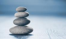 Stack Of Zen Stones On Blue Ba...
