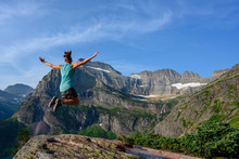 Woman Jumps With Mountain View