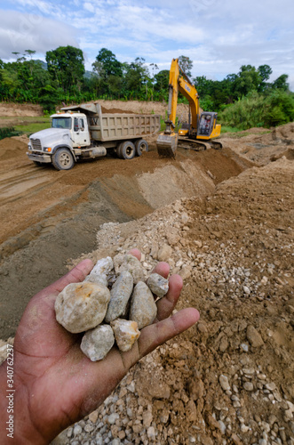 hands with stones in a concrete aggregate mine Wallpaper Mural