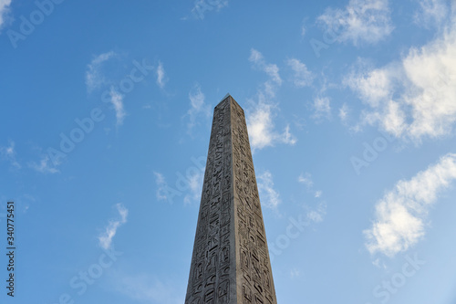 Fototapeta The Luxor Obelisk or Egyptian obelisk on the Place de la Concorde against a blue sky in Paris, France