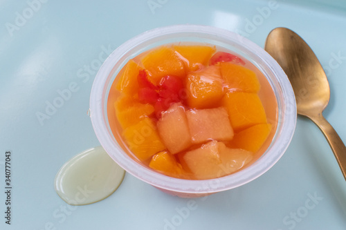 fruit cup of peaches and cherries on bright clean background