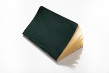 Paper Note Pad With Green Cover On White Background.
