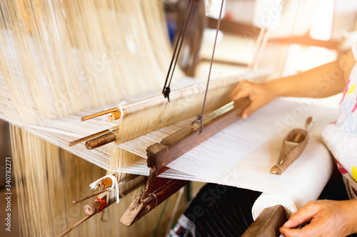 Fototapeta oriental traditional cloth making wooden equipment tools and technique creating