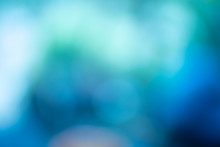 Green-blue Bokeh Abstract Light Background.