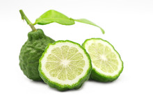 Raw Organic Whole Bergamot Or Kaffir And A Half On White Isolated Background. Bergamot Is Thai Popular Aromatic Herb For Cuisine And Cooking Food. Sour Taste Seasoning And Food Ingredients Concept.
