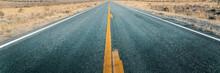 Long Straight Road Through Desert, Empty Street Leading Into Horizon, Two Lanes Asphalt Route