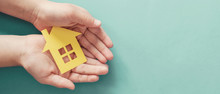 Hands Holding Paper House, Family Home, Homeless Housing And Home Protecting Insurance Concept, International Day Of Families, Foster Home Care, Homeschooling, Social Distancing