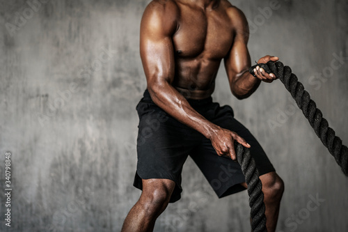 Battle ropes exercise Fotobehang