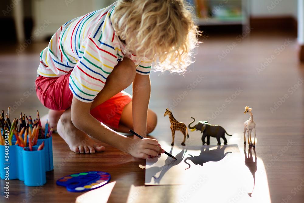 Fototapeta Little boy shadow drawing animals.