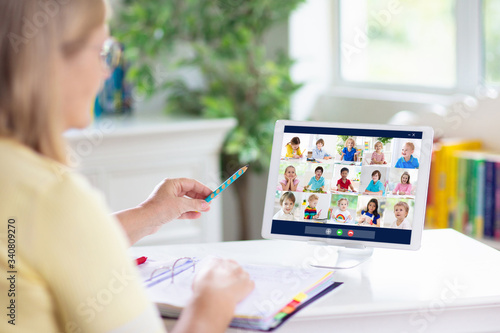 Photo Online remote learning. Teacher with computer.