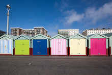 Beach Huts On Hove Seafront In Brighton, Sussex, UK, With Apartment Block Buildings