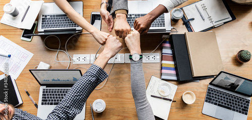Colleagues giving a fist bump Canvas