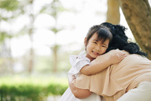 Crying Little Vietnamese Girl Hugging Her Grandmother She Was Missing Very Much During Quarantine Period