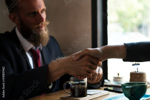 Business agreement handshake at coffee shop Canvas Print