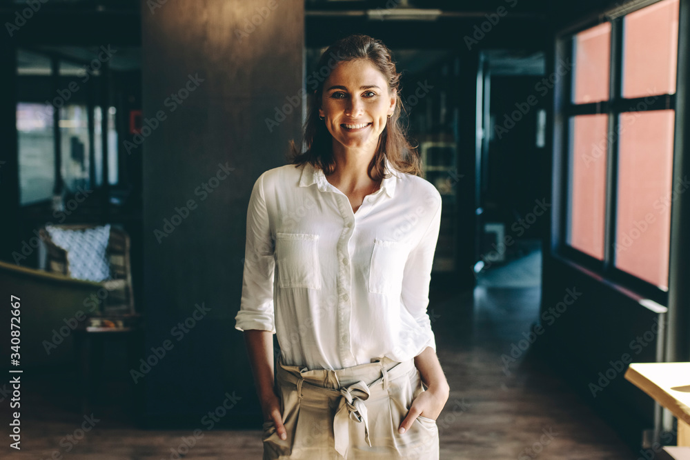 Fototapeta Confident entrepreneur standing in office